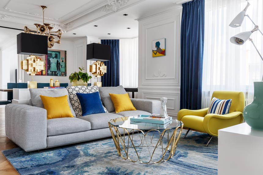 Part of colorful home interior: A modern living room with a striking color palette against a white backdrop. Image: Covet House/Sergey Krasyuk.