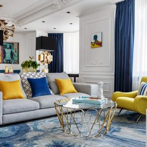 A modern living room with a striking color palette against a white backdrop. Image: Covet House/Sergey Krasyuk.