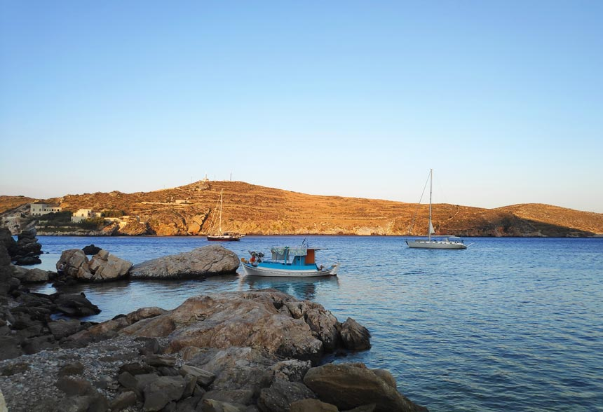 A seascape with two sailing boats and a fishing boat in Syros in landscape format.