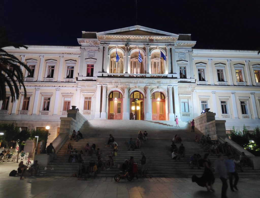 The Town Hall of Hermoupolis in Syros at night, pictured with a smartphone. In this image the stairs appear more.