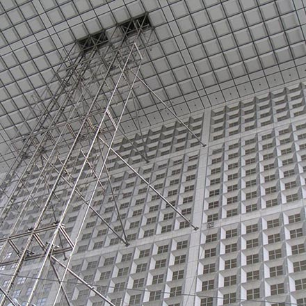 Looking up from under the cubic building of the Arche de la Defense in Paris. Image by Velvet.