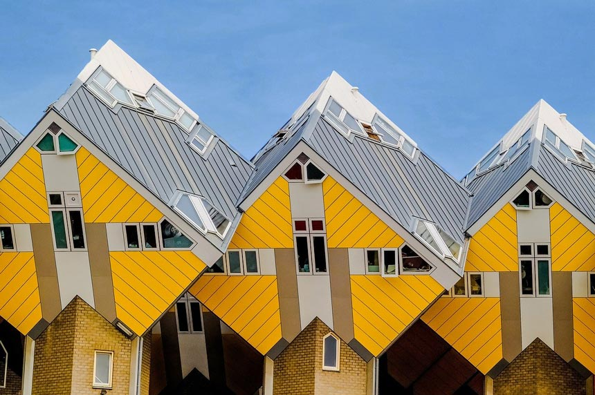 Closer view at three Cubic Houses with their distinctive yellow zinc cladding, found at Rotterdam, Netherlands.