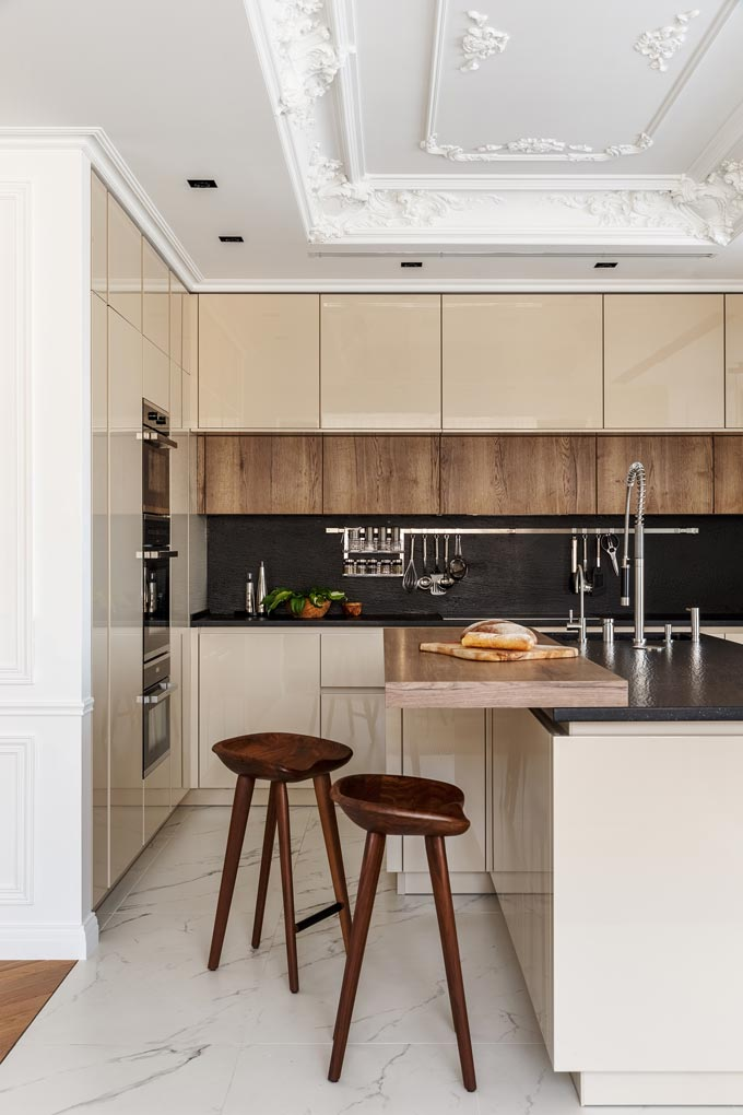Closer view of the beige tone contemporary kitchen of a luxurious apartment in Moscow. Image: Covet House/Sergey Krasyuk.