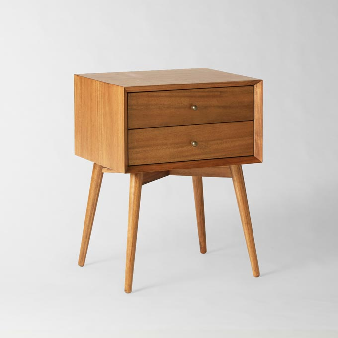 A stylish wooden Mid Century nightstand. Photo credit: West Elm.