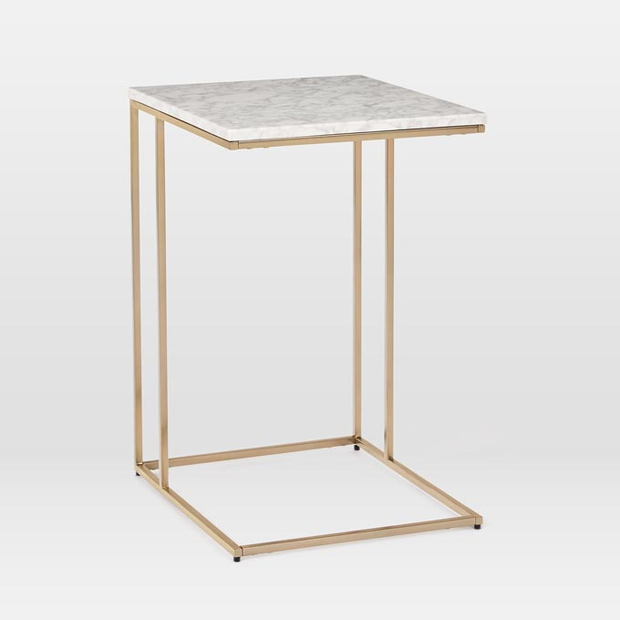 A side table with a white marble top and brassy frame like this can make a great looking bedside table. Photo: West Elm.