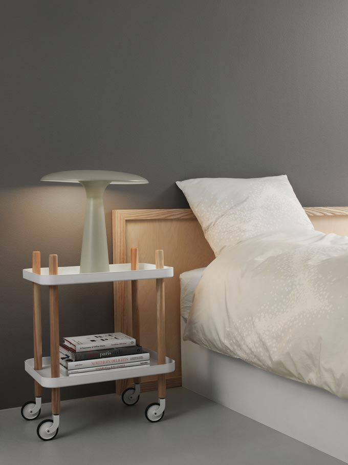 Normann Copenhagen Block Side Table serving as a nightstand in a muted green bedroom. Gorgeous. Image: Nest.co.uk.