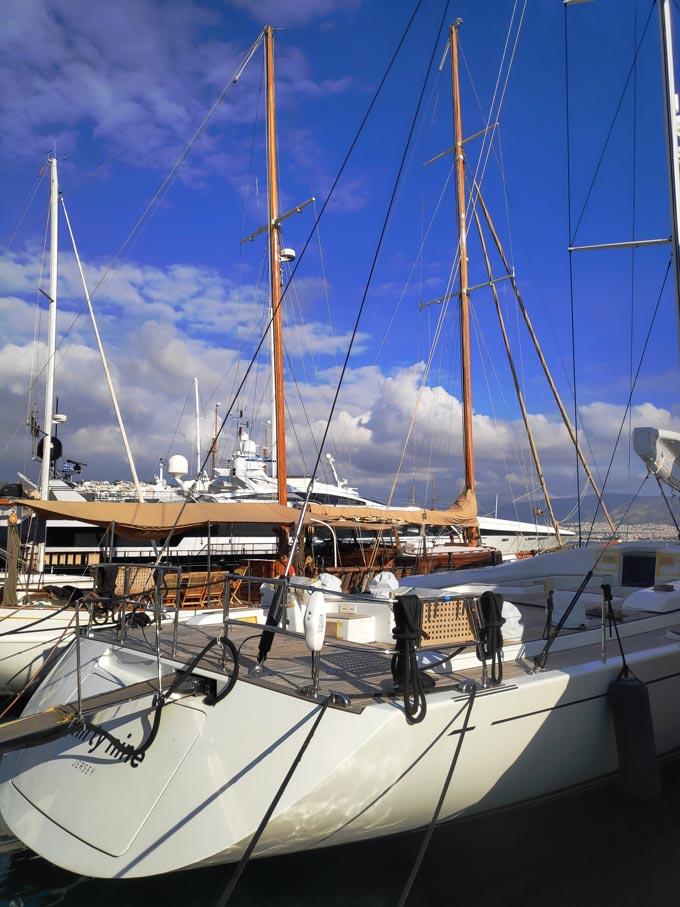 Sailing boats and yachts docked at a marina.