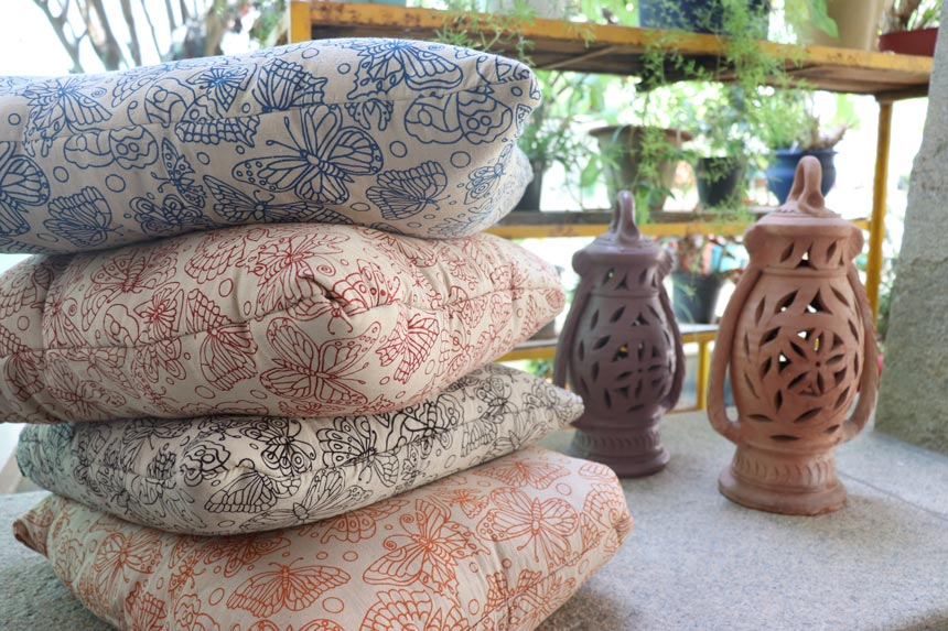 A stack of four pillows with a butterfly print on them. Image: Secret Projects.