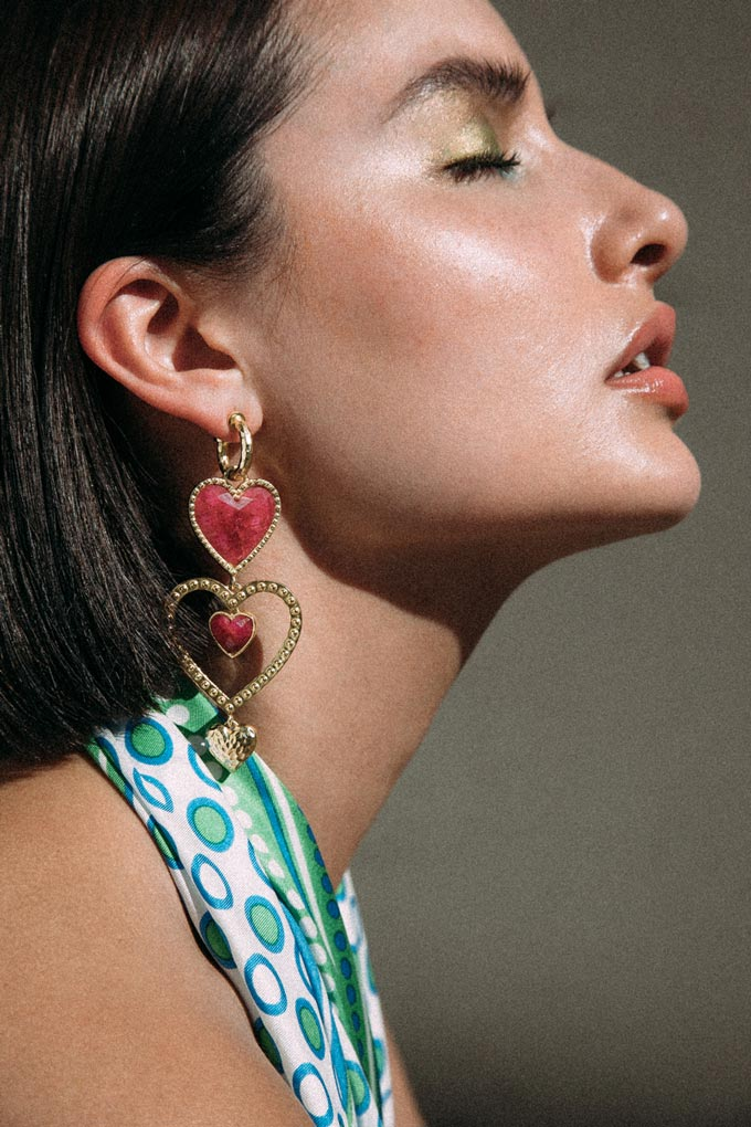 Latest Jewerly trends: Colored jewelry. A statement earring with hearts never goes un-noticed. Image: Mountain & Moon.