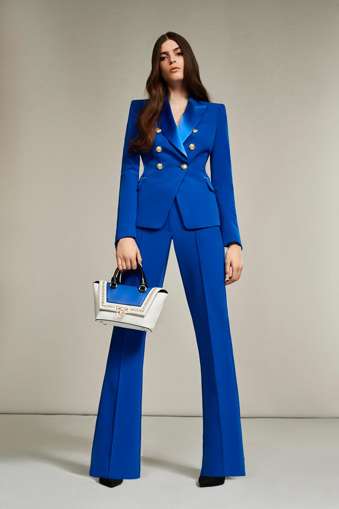 A Pantone's Classic Blue power suit styled with a white and blue handbag. Trendy and eye catching. Image: Debenhams.