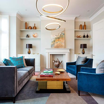 A bright and colorful contemporary living room with a distinct modern British flair. Designed by Zulufish. Image credit: Brabbu Design Forces.