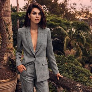 A sexy grey check power suit will not fail you. Image: SABA