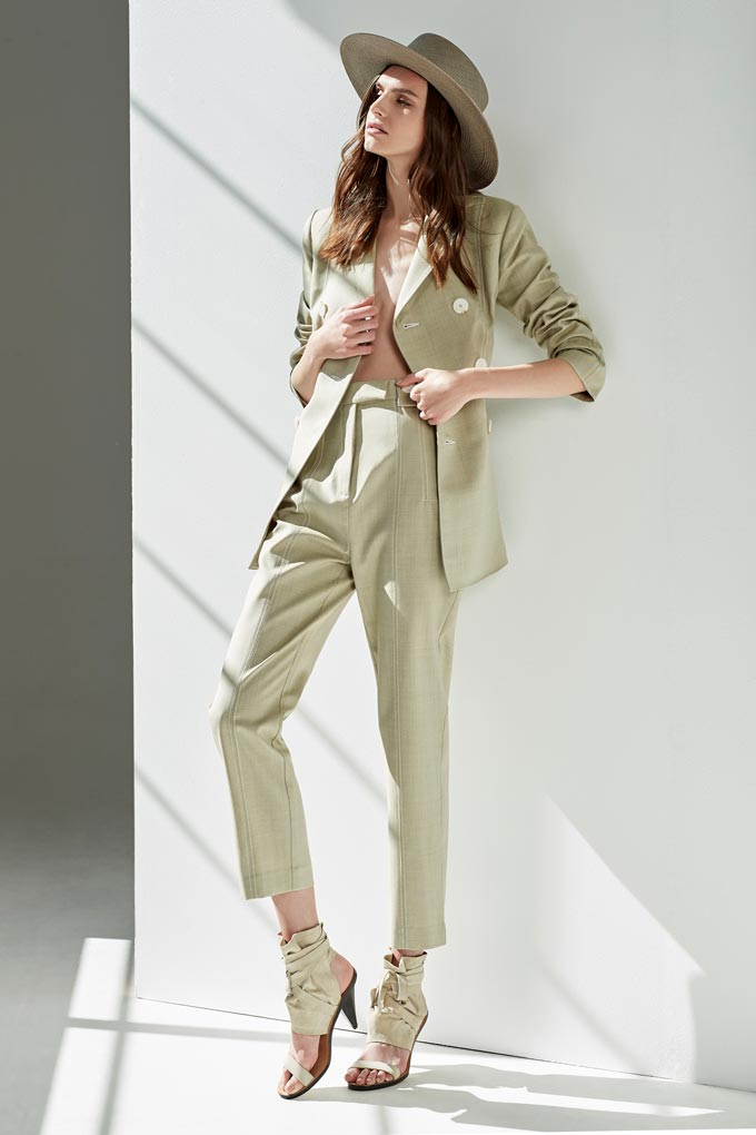 A stylish all pastel green power suit paired with a similar color hat and strappy high heel sandals. Image: Order of Style.
