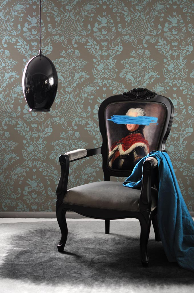 A rather unusual artistic way of using velvet in home decorating is this antique style Birchwood armchair with a printed velvet backrest of defaced classical artworks. Image: Mineheart.