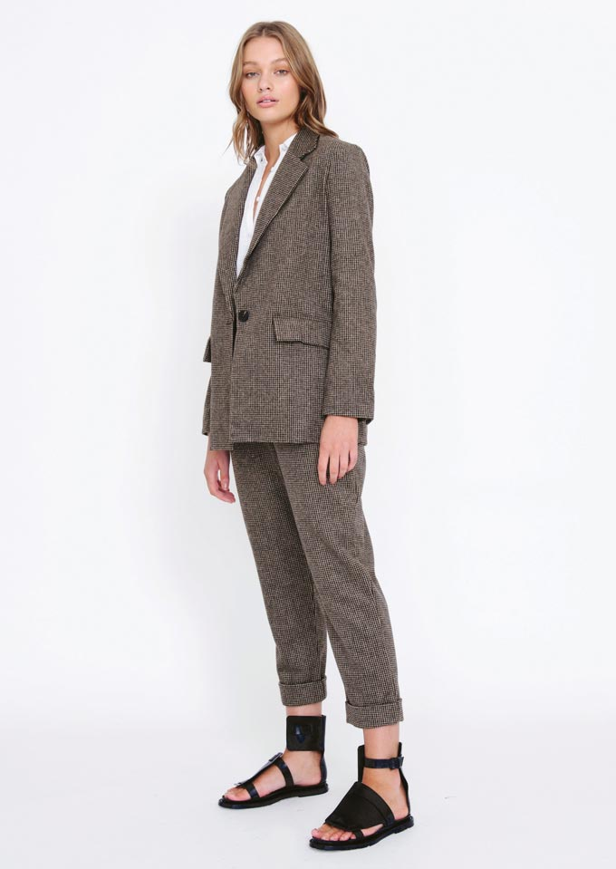 A suit with a small houndstooth print pattern. Ideal for the transition from winter to spring. Image: Morrison.