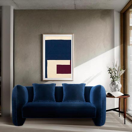 The Jacob sofa. A beautiful blue velvet sofa with some edgy cures in a minimal contemporary setting. Image: Collector.