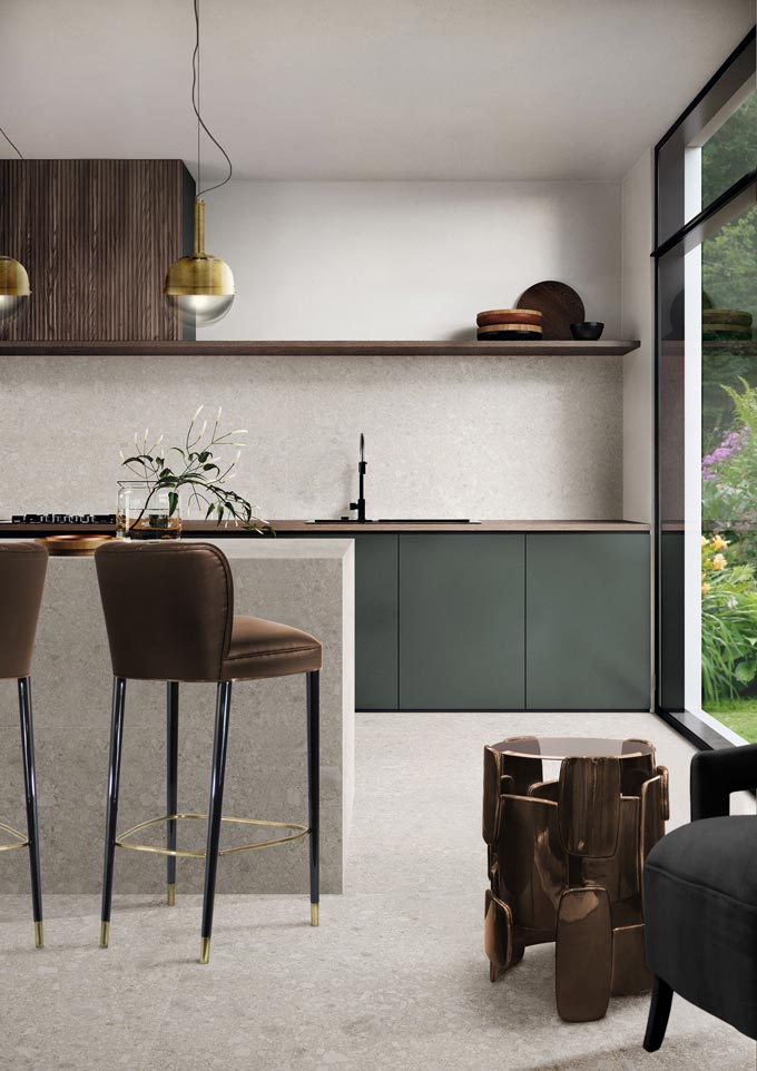 A minimal contemporary kitchen with dark wood stain upper cabinetry, muted fir green lower cabinetry and terrazzo. Fantastic. Image: Brabbu Design Forces.