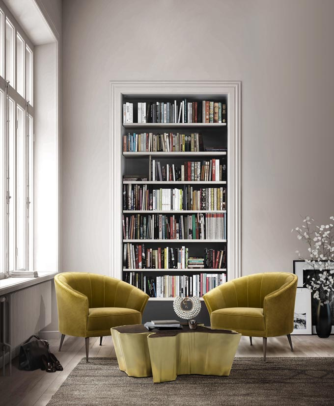 Decorating in velvet has such perks, like this vignette with two velvet armchairs in front of a bookcase wall insert. Image: Brabbu Design Forces.