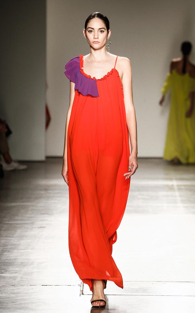 Asymmetrical pull over sheer maxi dress with left side seam slit. Contrasting frill and gathered detail on front and back. Image: Haus of Song.