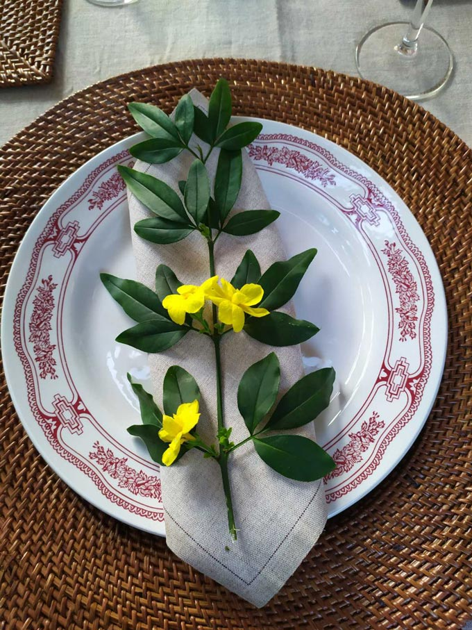 A place setting for Easter dining, set up by Elisabeth with a yellow wildflower as decor.