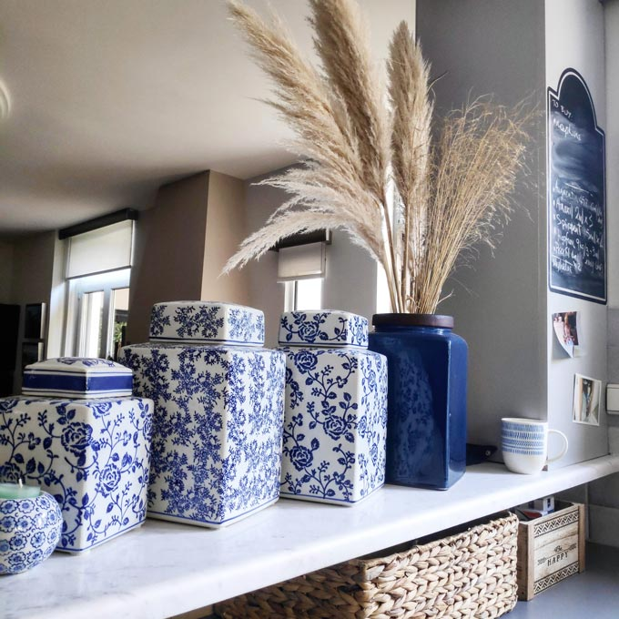 Natural touch from natural materials combined with blue-based vases.