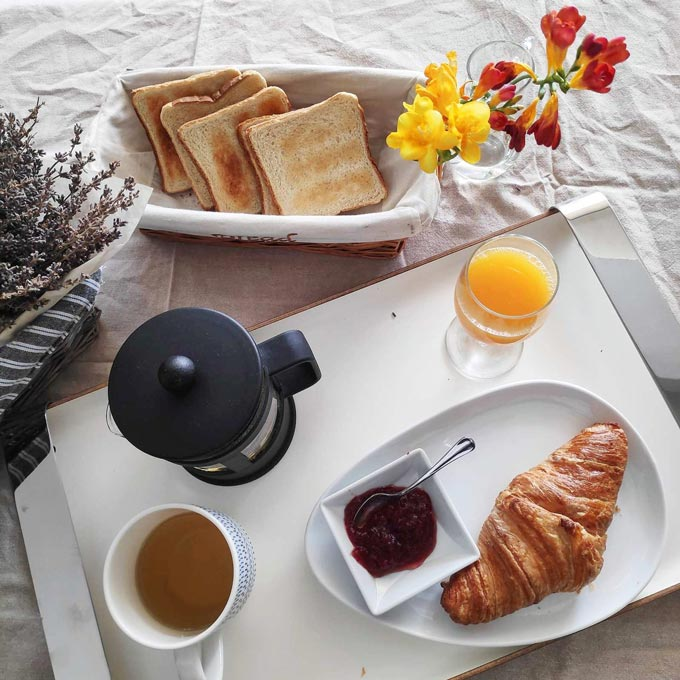 Pretty Breakfast was the theme of this shot featuring freshly squeezed orange juice, tea, croissant and toasted bread.