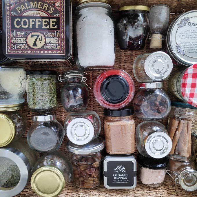 A flatlay image of bottled spices, herbs and coffee beans.
